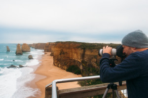 Photographer (Jon Sander) photographing the 12 Apostles with a telephoto lens