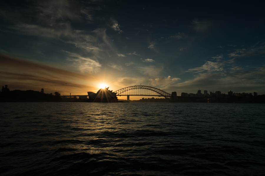 Sun setting behind the Sydney Opera House